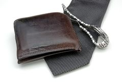 Mens accessories. 3 mens accessories, a watch, wallet, and tie royalty free stock photos