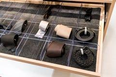 Mens accessories in closet drawer. Necktie, belt, ribbon, sunglasses stock images