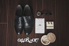 Shoes, watch and ring on the floor 534. Mens accessories on the parquet floor Stock Photos