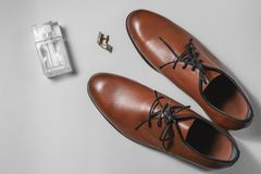 Shoes with perfume and cuff. Mens accessories. Shoes with perfume and cuff Royalty Free Stock Photos
