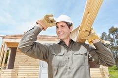 Mens als de bouwvakkerbouw huis stock afbeeldingen