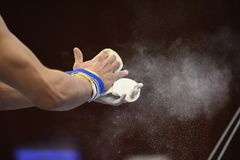 Mens Artistic Gymnastics hands Close up Grips and Chalk. Power gymnastic concept royalty free stock photos