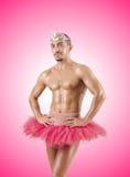 Mens in ballettutu tegen de gradiënt Stock Foto