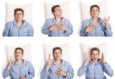 Mens in bed die verschillende uitdrukkingen tonen stock afbeelding