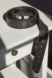 Mens belt on a bedstand Royalty Free Stock Photo