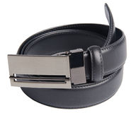 Mens belts on a background Royalty Free Stock Photos