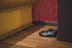 Mens black dress shoes near the closet. Mens shoes waiting for the master stock image