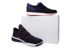 Mens black sport shoes near the white box Stock Photography