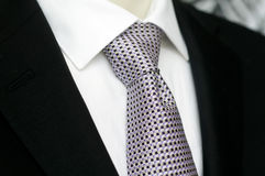 Mens black suit and sharp looking tie Stock Photography