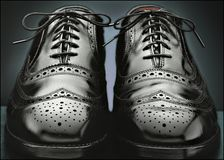 Mens black wingtip shoes Stock Photo