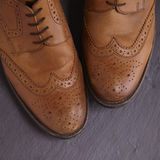 Mens brogues. Mens brown brogues on a slate floor Royalty Free Stock Images