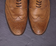 Mens brogues. Mens brown brogues on a slate floor Stock Images