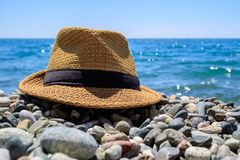 Mens brown braided hat lying on the seashore Royalty Free Stock Images