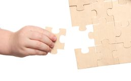 Mens and childs hands finishing puzzles Royalty Free Stock Photo