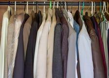 Mens cloths hanging Stock Photo