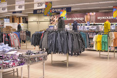 Mens clothing on hangers. In shop Stock Photo