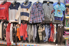 Mens clothing on hangers. In shop Stock Photos