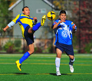 Mens club Soccer kick Stock Images