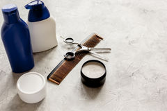 Mens cosmetics for hair in bottle at bathroom Stock Photos