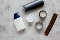 Mens cosmetics for hair in bottle gray background top view Royalty Free Stock Image