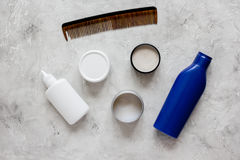 Mens cosmetics for hair in bottle gray background top view Royalty Free Stock Photo