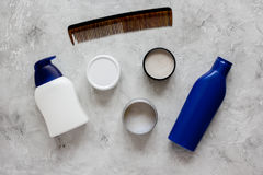 Mens cosmetics for hair in bottle gray background top view Royalty Free Stock Photography