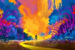 Mens die aan abstract kleurrijk landschap lopen Royalty-vrije Stock Afbeelding