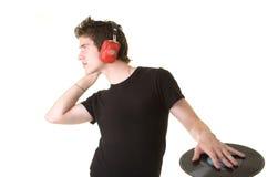 Mens die aan de muziek luistert Stock Foto