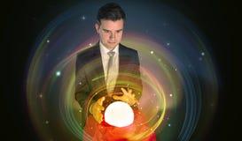 Mens die aan de toekomst van het woord in een magische bal kijken stock afbeelding