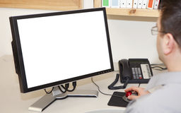 Mens die aan een computer werkt stock afbeelding