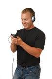 Mens die aan muziek luistert Royalty-vrije Stock Afbeelding