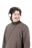 Mens die aan muziek luistert Stock Afbeelding