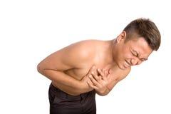 Mens die aan pijn op zijn borst lijdt royalty-vrije stock afbeelding