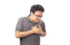 Mens die borst aan pijn op witte achtergrond lijden Stock Afbeeldingen
