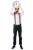 Mens die bretels dragen die grote klok houden Royalty-vrije Stock Afbeelding