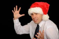 Mens die de hoed van de Kerstman draagt Royalty-vrije Stock Foto's