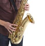 Mens die de saxofoon speelt Stock Foto