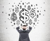 Mens die dollartekens bekijken Royalty-vrije Stock Afbeeldingen