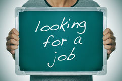 Mens die een baan zoeken Stock Foto's
