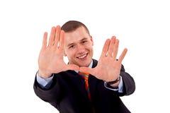 Mens die een frame met zijn handen maakt Royalty-vrije Stock Fotografie