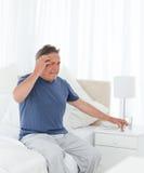 Mens die een hoofdpijn heeft Royalty-vrije Stock Afbeeldingen