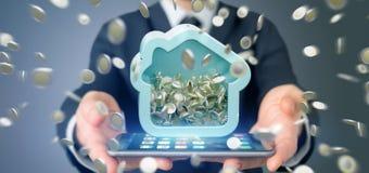 Mens die een Huis moneybox met muntstuk houden die overal 3d r omringen Stock Foto