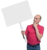 Mens die een stok met een lege affiche houden Geïsoleerde royalty-vrije stock fotografie