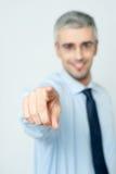Mens die een vinger naar u richten stock afbeeldingen