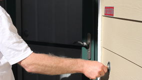 Man Ringing Front Door Bell and Knocking Stock Footage