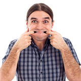 Mens die grappig gezicht maakt Stock Afbeeldingen