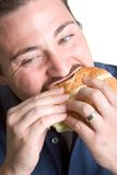 Mens die Hamburger eet royalty-vrije stock foto's