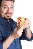 Mens die Hamburger eet royalty-vrije stock afbeelding