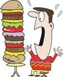 Mens die hamburgerbeeldverhaal eet Stock Fotografie