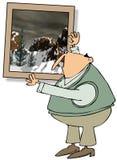 Mens die het grote schilderen hangen Stock Foto's